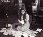 Mary Pickford reads her fan mail - 1916