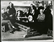 United Artists formation: 1. Dennis O'Brien, lawyer 2. Hiram Abrams, lawyer 3. Witness 4. Mary Pickford 5. William Gibbs McAdoo, consultant 6. unknown 7. Douglas Fairbanks 8. Witness -- Seated: 1. D.W. Griffith 2. Oscar Price, lawyer - 1919