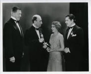 William C. DeMille presents Mary Pickford with her Oscar for Coquette; actor Warner Baxter is on Mary's left - 1930