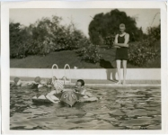 Mary Pickford and Douglas Fairbanks at a Pickfair pool party - 1922 (ca.)