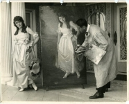Mary Pickford posing for artist Matteo Sandona in her home on Fremont Place, Los Angeles. The life-size portrait was for the National Gallery in Washington, D.C. - 1919