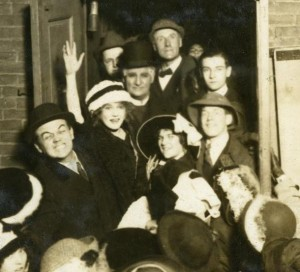 Mary Pickford greeted by fans outside a theater, 1913