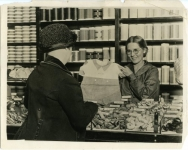 Publicity photo of Mary working in a department store, incognito, to gain experience as a saleslady prior to working on the film My Best Girl - 1927