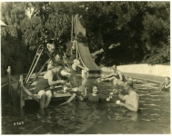 Mary Pickford serves tea to the crew of Tess of the Storm Country after filming a scene in her pool at Pickfair - 1922