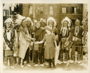 Mary Pickford meets Sioux tribe leaders on the set of Little Annie Rooney - 1925