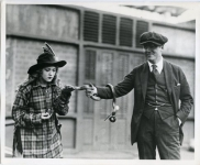 Mary Pickford with Marshall Neilan and snake on the set of M'Liss - 1918