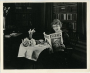 Mary Pickford reading Green Room, an Australian trade paper - 1918