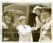 Col. H.N. Arnold, Commandant March Field, Amelia Earhart, Mary and Lieut. Tommy Tomlinson, noted flyer - 1935