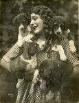 Mary Pickford with puppies, photo by K.O. Rahmn - 1925