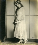 Mary Pickford with flowers, portrait by Peyton - 1916