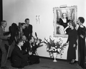Mary with Greenman being photographed with painting (1935)